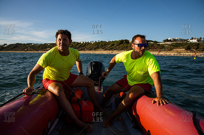 Lifeguards in the outboard inflatable boat to the rescue of a swimmer