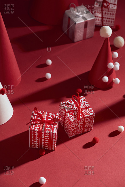 Handmade christmas tree and Christmas presents in red boxes