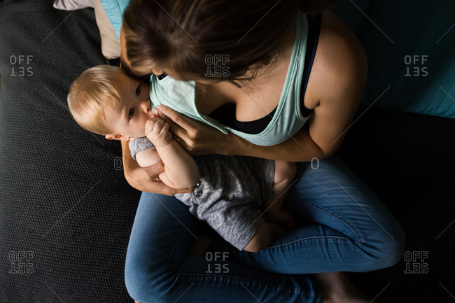 Overhead view of woman nursing her infant son