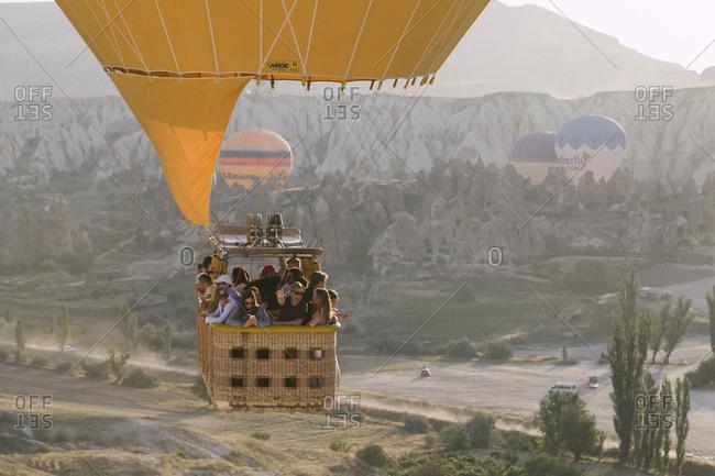 Cappadocia, Turkey - Jul 31, 2019: People in a hot air balloon at Cappadocia