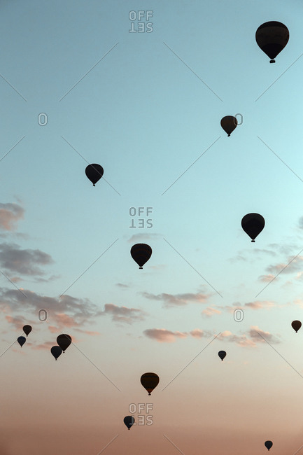 Silhouettes of flying air balloons at sunset, Cappadocia, Turkey