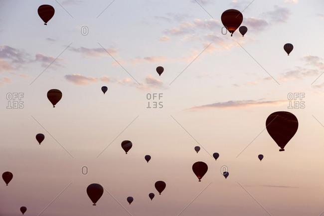 Silhouettes of hot air balloons at sunset, Cappadocia, Turkey
