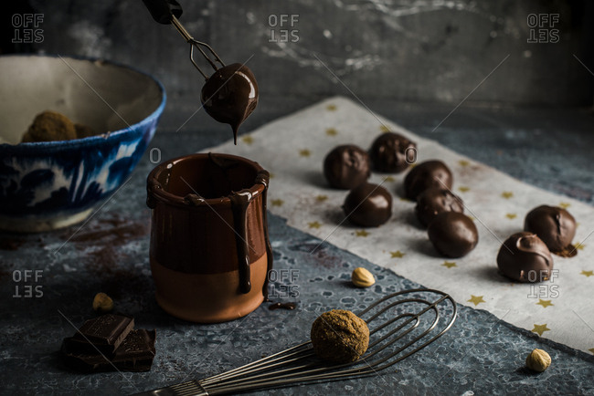 Hazelnut truffles dipped in melted chocolate