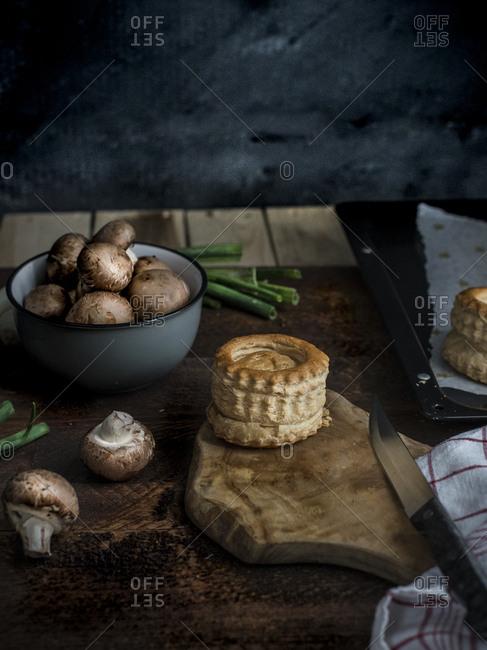 Preparing a vegetarian vol au vent with leeks, cheese, and mushrooms