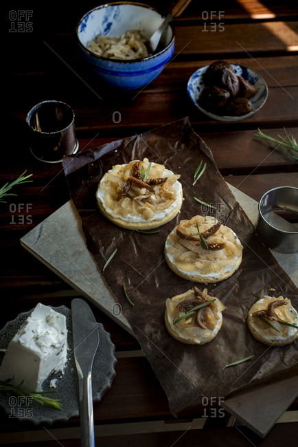 Round salty-sweet onion toast topped with goal cheese and dried fig
