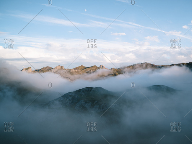 Cloud inversion in high altitude mountains during golden hour in Pyrenees