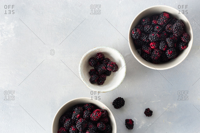 Bowls of fresh blackberries overhead view