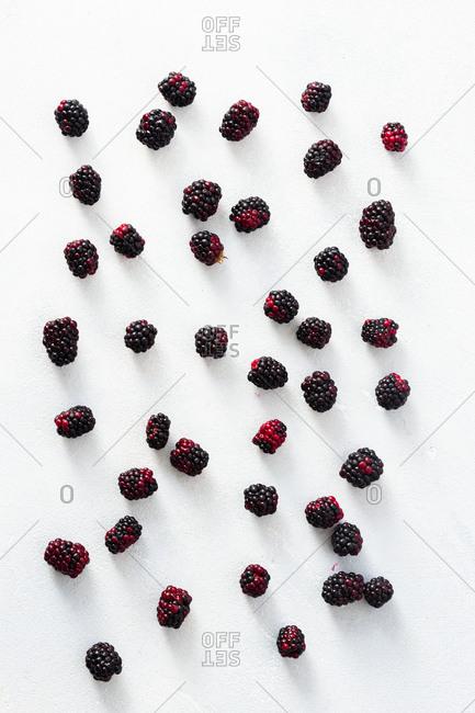 Fresh blackberries scattered on a table