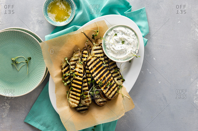 Grilled eggplants served with tzatziki sauce