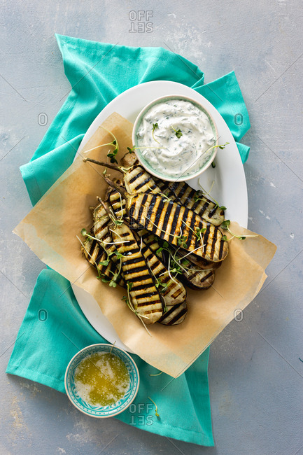 Overhead view of grilled eggplants  and tzatziki sauce