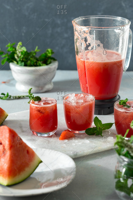 Making summer watermelon mojitos