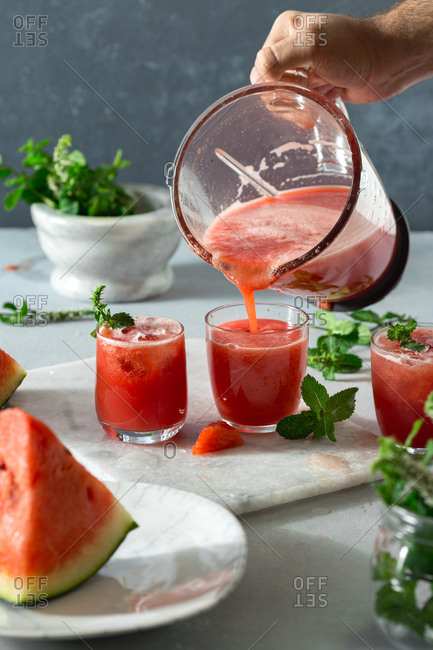 Pouring summer watermelon cocktails