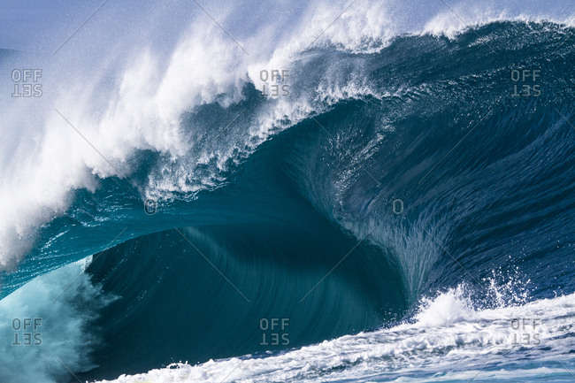 Close up of a huge and powerful wave breaking in Tahiti 2