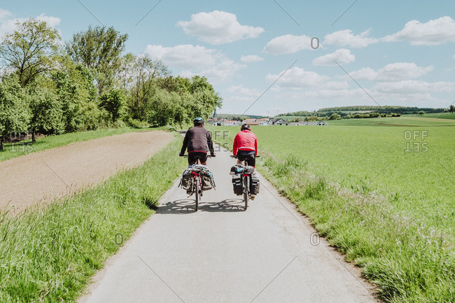 Two cyclists riding his bikes in a bike line, Germany