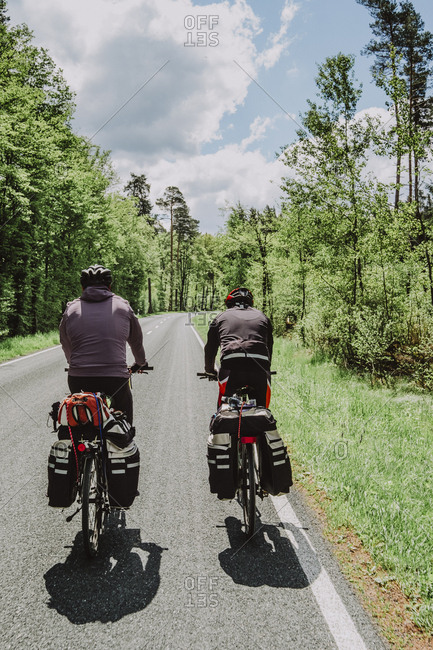 Cyclists riding bikes in the forest, Germany
