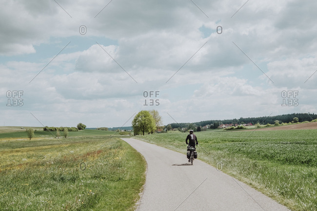 A cyclist riding his bike with bike packing in Germany
