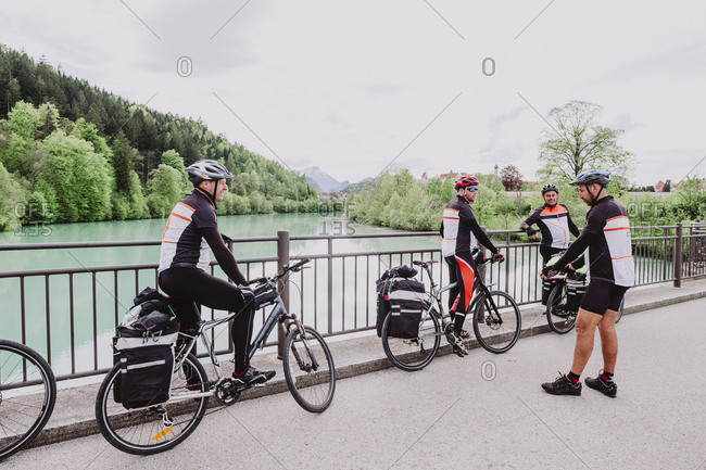 A group of cyclist resting in a river in the Romantische Strasse route