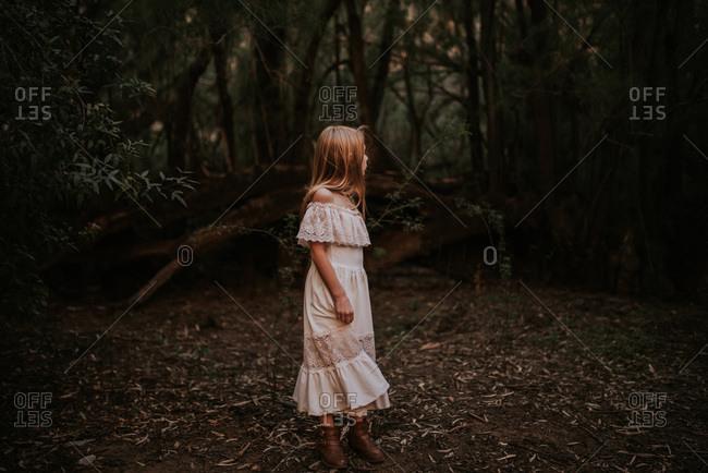 Girl in the woods looking over her shoulder