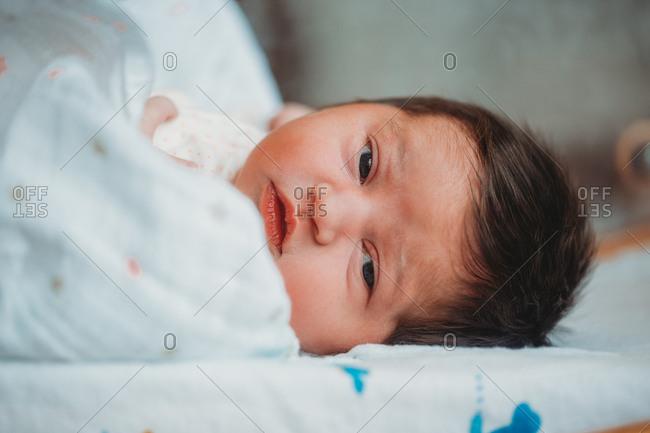 Newborn Baby Girl in hospital eyes wide open
