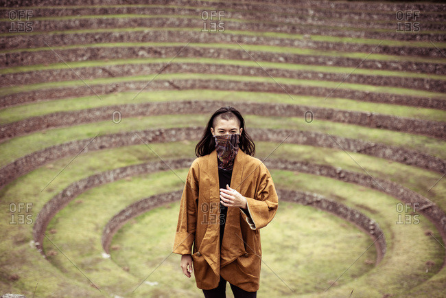 androgynous ninja stands in center of ancient Inca stone circles