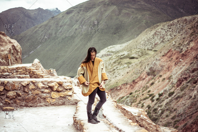 Androgynous mixed race dancer  in salt farm on mountain side