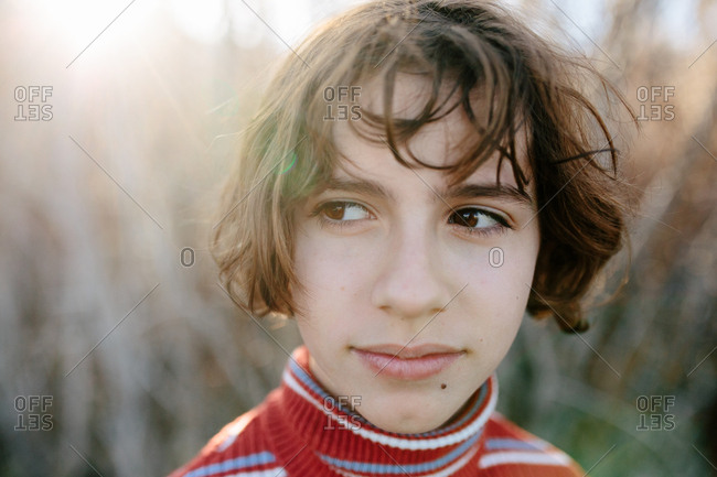 Closeup portrait of a young teen girl with a sideways glance