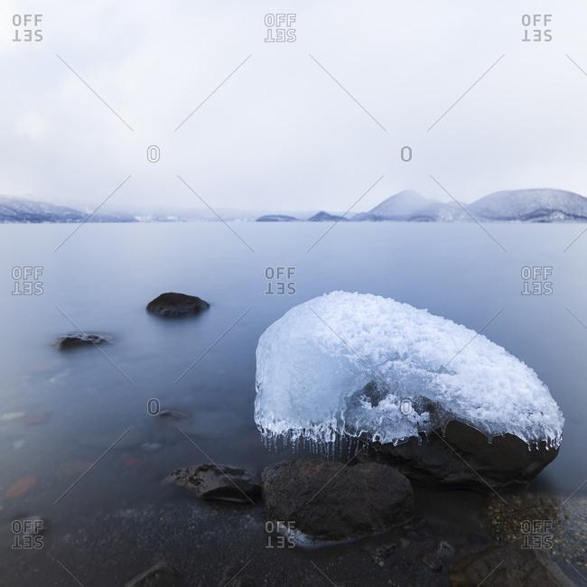 Long exposure shot of rock covered in ice at Lake Toya, Hokkaido, japan