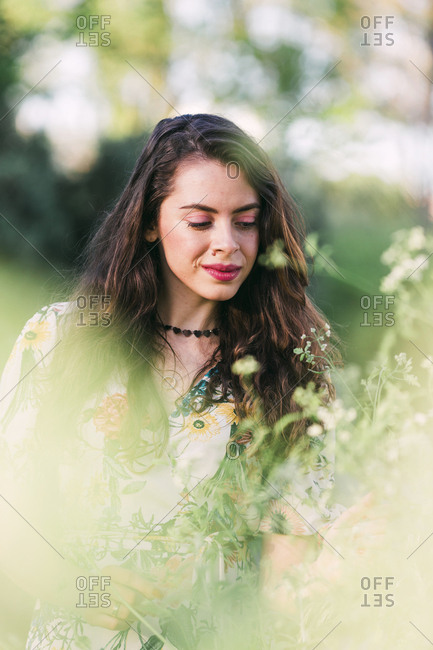 Portrait of beautiful young woman in park.