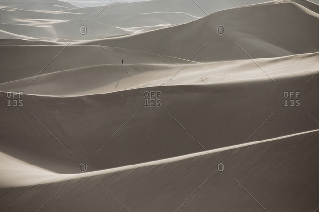 Hiker on a distant ridge in Great Sand Dunes National Park Colorado