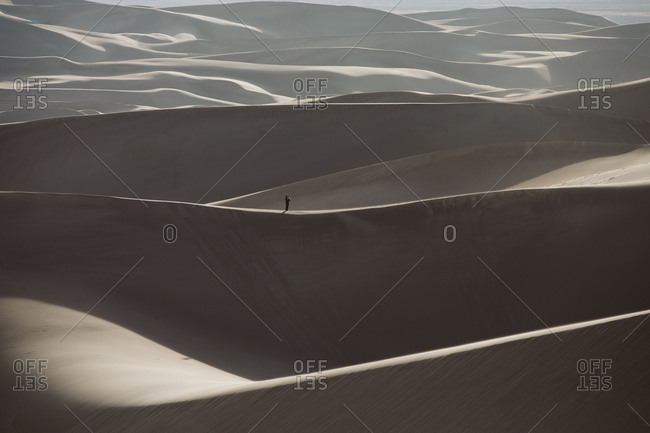Distant hiker gives perspective to the vast Colorado sand dunes
