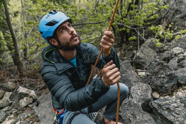 Rock climber belaying top rope