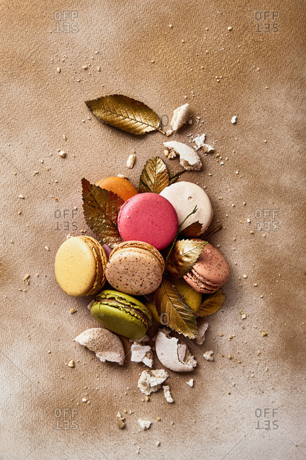 Macarons with golden leaves on a golden sprayed background