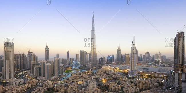 March 17, 2019: Panoramic view of Dubai skyline and Burj Khalifa under golden light