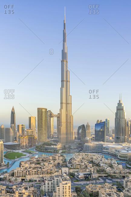 March 17, 2019: Dubai skyline in golden light with Burj Khalifa at sunrise