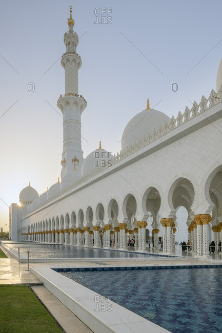 March 17, 2019: Sheikh Zayed Mosque and reflecting pools in golden hour, Dubai, UAE