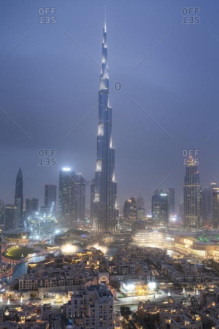 March 17, 2019: Burj Khalifa and Dubai skyline under lights during blue hour