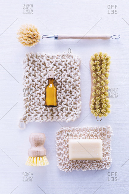 Ecologically friendly brushes, cleaning rags, soap and baking soda
