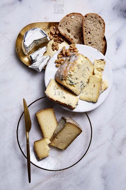 Assortment of cheese on a marble table top