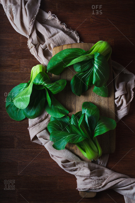 Fresh baby bok choy on a wooden background