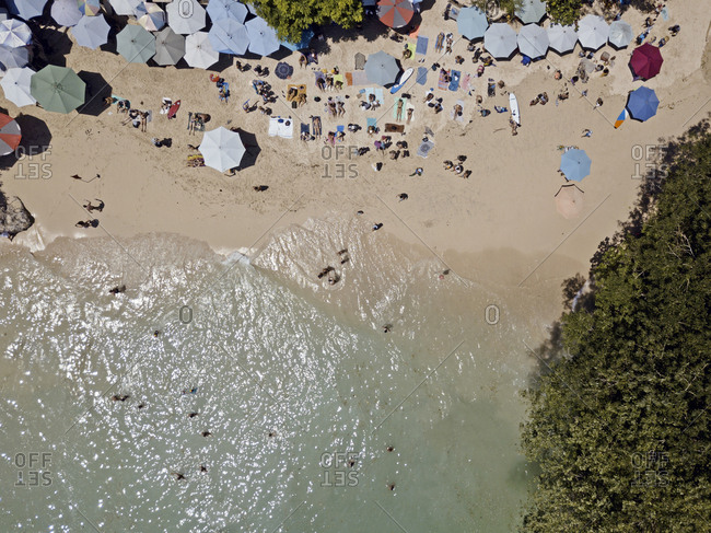 Bali, Indonesia - August, 25, 2019: Beachgoers at Padang Padang beach seen from above