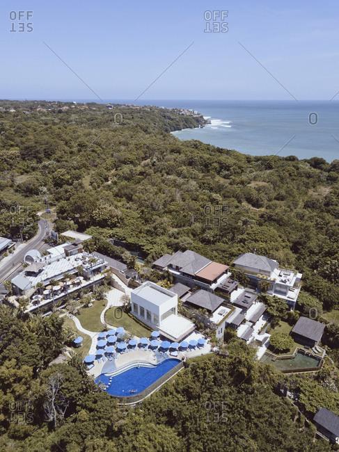 Bali, Indonesia - August, 25, 2019: Aerial view of resort with pool by Padang Padang beach