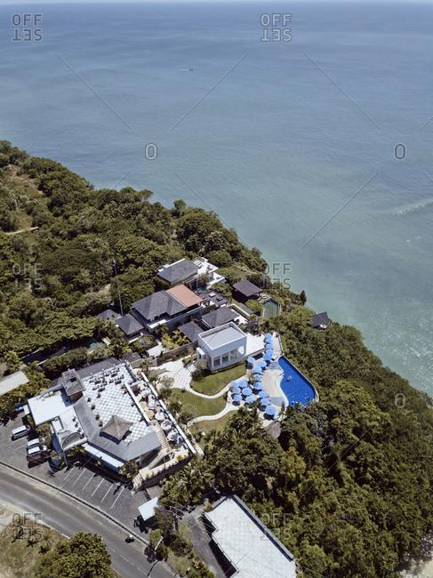 Bali, Indonesia - August, 25, 2019: Aerial view of a resort with swimming pool at Padang Padang beach