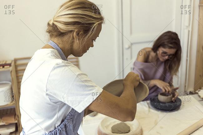 Women working in clay workshop