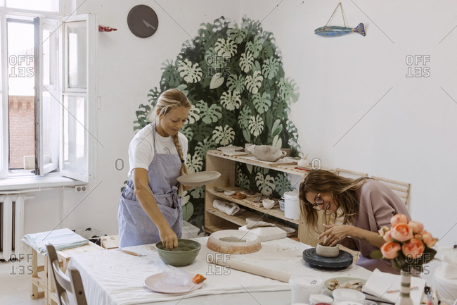 Two women working in clay workshop