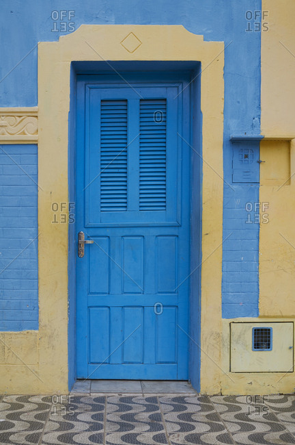 Home with colorful blue and yellow facade, Guamare, Rio Grande do Norte, Brazil