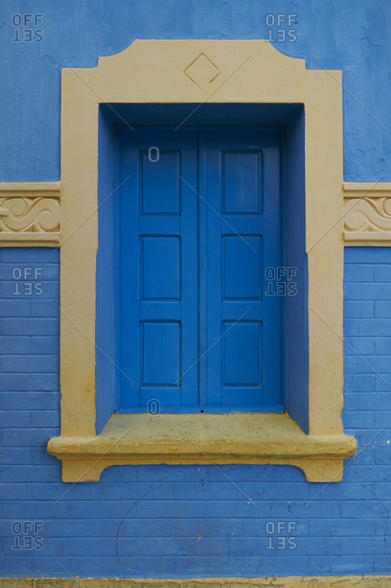 Window with blue shutters and yellow trim, Guamare, Rio Grande do Norte, Brazil