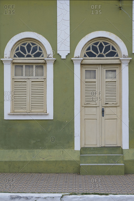 Home with green, white and tan facade, Guamare, Rio Grande do Norte, Brazil
