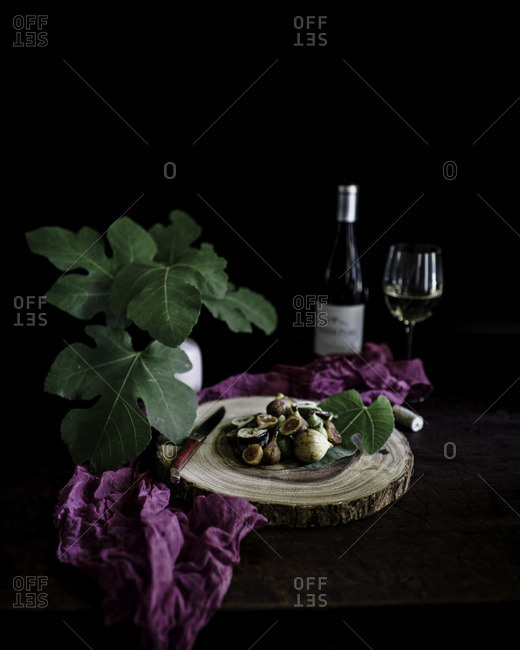 Ripe figs displayed with wine glass and bottle