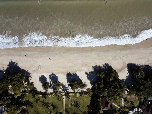 Aerial view of Jimbaran beach and beachside resorts, Bali, Indonesia