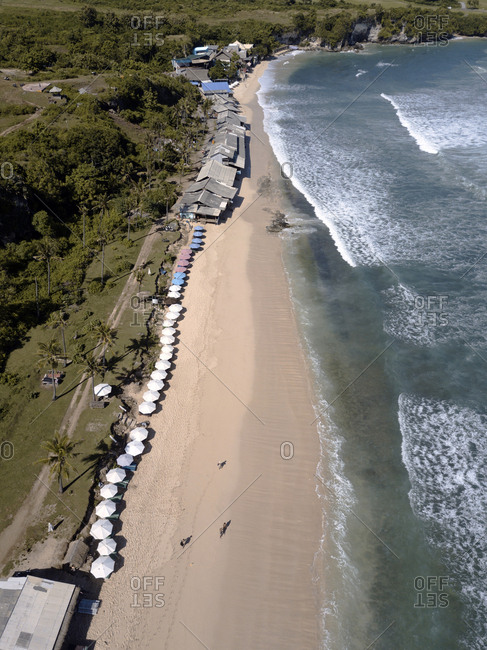 Bird's eye view of people walking on Balangan beach, Bali, Indonesia